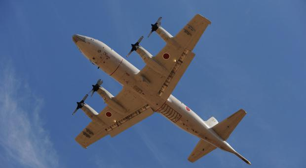 PERTH, AUSTRALIA - APRIL 17: A Japan Orion aircraft takes off from Pearce Airbase, in Bullsbrook, 35 kms north of Perth to help in the search for missing Malaysia Airlines flight MH370, on April 17, 2014 in Perth, Australia. Twenty-six nations have been involved in the search for Malaysia Airlines Flight MH370 since it disappeared more than a month ago. The Malaysian Airways aircraft went missing on 8th March 2014 whilst on a flight between Kuala Lumpur and Beijing. (Photo by Greg Pool - Pool/Getty Images)