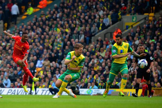 Raheem Sterling of Liverpool scores the opening goal during the Barclays Premier League match between Norwich City and Liverpool at Carrow Road on April 20, 2014 in Norwich, England. (Photo by Michael Regan/Getty Images)