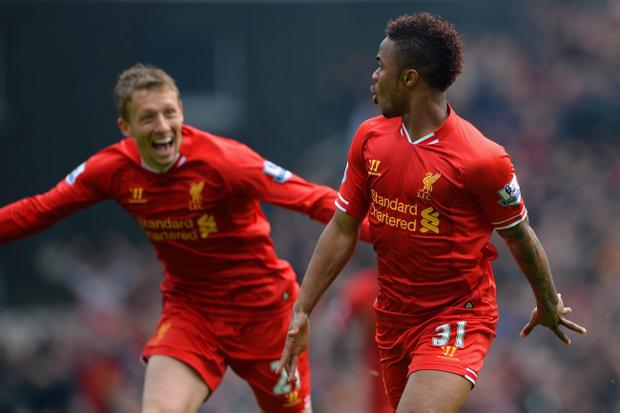 NORWICH, ENGLAND - APRIL 20: Raheem Sterling of Liverpool celebrates scoring the opening goal with Lucas Leiva of Liverpool during the Barclays Premier League match between Norwich City and Liverpool at Carrow Road on April 20, 2014 in Norwich, England. (Photo by Michael Regan/Getty Images)