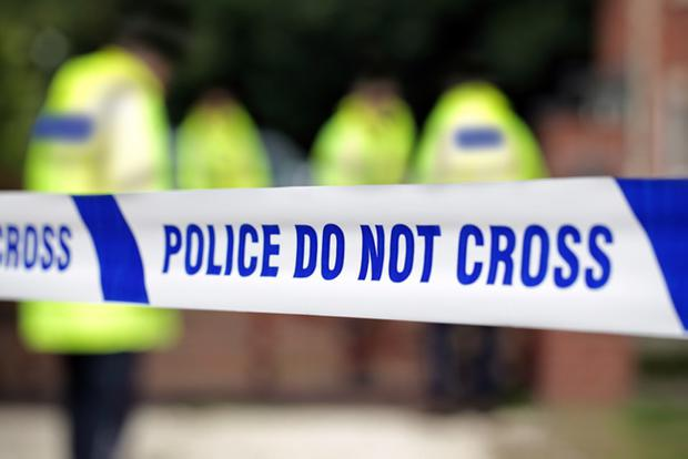 The woman's body was found in west Belfast on the morning of Easter Sunday