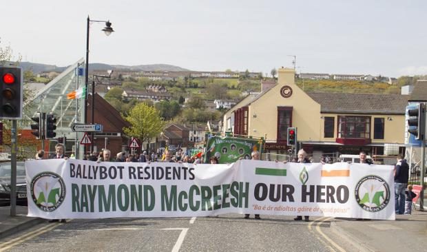 A large banner from the Barcroft residents supporting Raymond McCreesh . The annual Easter Commemoration Parade took place in Newry city, with about 300 people parading to the republican plot at St Mary's Graveyard. Newraypics