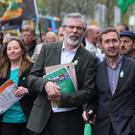 Sinn Fein leader Gerry Adams (centre) chats with colleague Eoin O Broin during the Sinn Fein commemoration to mark the 98th anniversary of the 1916 Easter Rising in Dublin