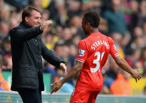 Raheem Sterling of Liverpool celebrates scoring a goal with manager Brendan Rodgers (Photo by Michael Regan/Getty Images)