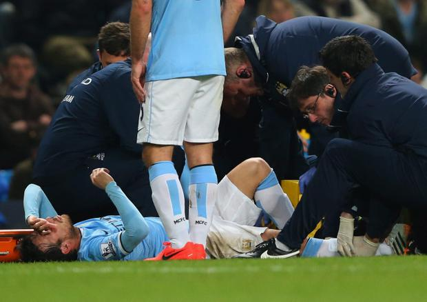 MANCHESTER, ENGLAND - APRIL 21: An injured David Silva of Manchester City is given treatment during the Barclays Premier League match between Manchester City and West Bromwich Albion at Etihad Stadium on April 21, 2014 in Manchester, England. (Photo by Alex Livesey/Getty Images)