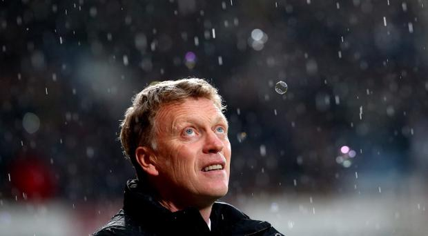 David Moyes looks on prior to kickoff during the Barclays Premier League match between West Ham United and Manchester United at Boleyn Ground on March 22, 2014 in London, England. Manchester United now face a daunting task as they look to replace Moyes and turn the club's fortunes around (Photo by Julian Finney/Getty Images)