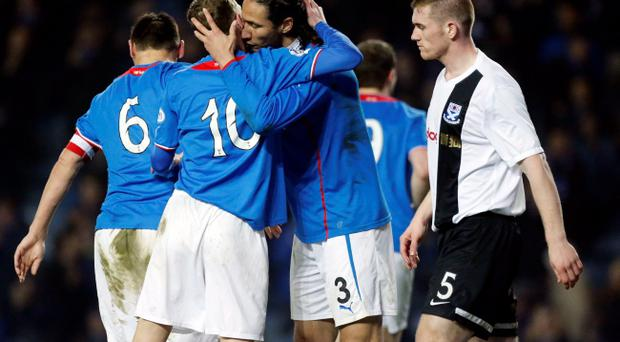 Rangers' Bilel Mohsni (centre) celebrates his goal with Dean Shiels (second left) while Ayr United's Alan Lithgow (right) looks dejected during the Scottish League One match at Ibrox, Glasgow.