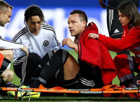 Chelsea's John Terry is placed on a stretcher after taking a knock during the Champions League semifinal first leg soccer match between Atletico Madrid and Chelsea at the Vicente Calderon stadium in Madrid, Spain, Tuesday, April 22, 2014. (AP Photo/Andres Kudacki)