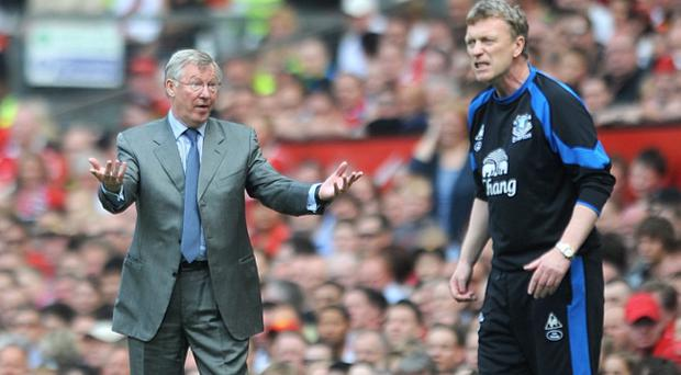 File photo dated 23/04/2011 of Everton manager David Moyes (right) shouting instructions to his team as he stands near Manchester United manager Alex Ferguson. Ferguson is believed to have been consulted by United ahead of the decision to sack David Moyes as his successor.
