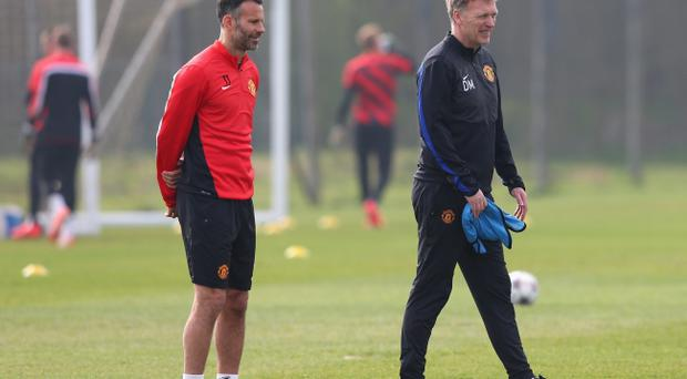 MANCHESTER, ENGLAND - MARCH 31: David Moyes the manager of Manchester United and Ryan Giggs look during a training session at the Aon Training Complex on March 31, 2014 in Manchester, England. (Photo by Alex Livesey/Getty Images)