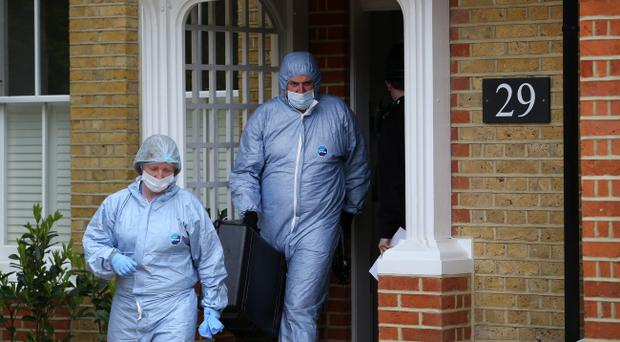 Police forensic officers leave a house in New Malden where the bodies of three children were found on April 23, 2014 in south London, England. Police say that a 43 year old woman has been arrested after the bodies of three children were found at a property last night. (Photo by Peter Macdiarmid/Getty Images)