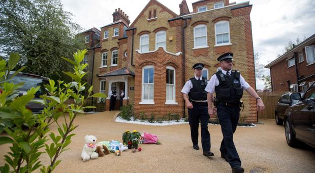 Police at a house in New Malden, south London, after a woman was arrested following the discovery of three dead children at the address.