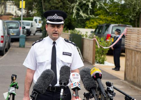 Chief Superintendant Glenn Tunstall speaks to media at a house in New Malden, south London, after a woman was arrested following the discovery of three dead children at the address.