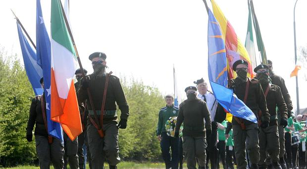 DEFIANT: The hardliners marching from the Kilwilkie Estate to St Colman's in full military dress
