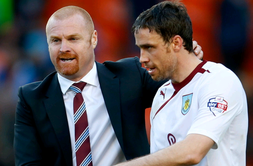 Michael Duff (right), pictured with Burnley manager Sean Dyche, played in 39 matches for his team this season. (Photo by Paul Thomas/Getty Images)