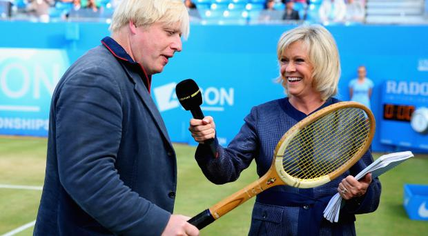 LONDON, ENGLAND - JUNE 16: London Mayor Boris Johnson speaks to Sue Barker ahead of the Rally Against Cancer charity match on day seven of the AEGON Championships at Queens Club on June 16, 2013 in London, England. (Photo by Julian Finney/Getty Images)