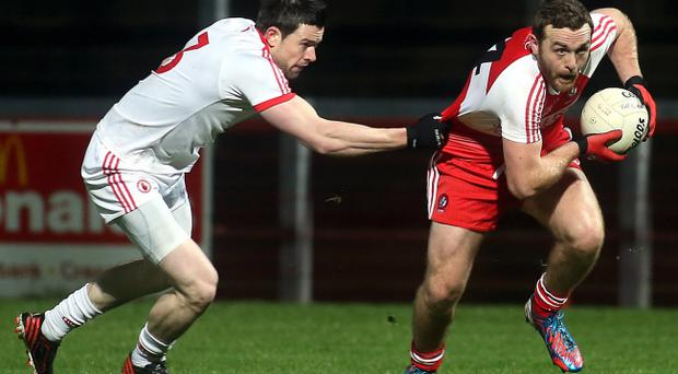 Derry's Emmett McGuckin and Tyrone's Conor Clarke