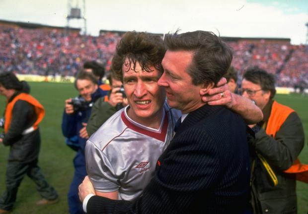 1986: Alex Ferguson (right) Manager of Aberdeen hugs Sandy Jardine (left) of Hearts in commiseration after the Scottish Cup Final match at Hampden Park in Glasgow, Scotland. Aberdeen won the match 3-0