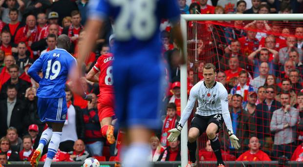 Demba Ba of Chelsea runs through on goal to score the first goal past Simon Mignolet of Liverpool during the Barclays Premier League match between Liverpool and Chelsea at Anfield