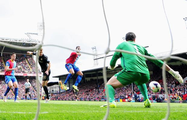 Edin Dzeko of Manchester City scores the opening goal during the Barclays Premier League match between Crystal Palace and Manchester City at Selhurst Park
