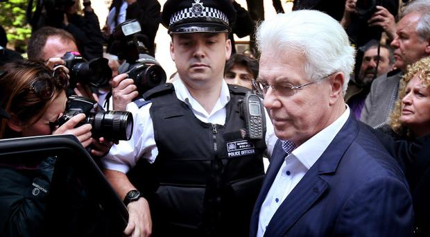 LONDON, ENGLAND - APRIL 28: Publicist Max Clifford (R) leaves Southwark Crown Court on April 28, 2014 in London, England. Mr Clifford has been found guilty of eight indecent assaults on women and girls as young as 15 by a jury at Southwark Crown Court. (Photo by Peter Macdiarmid/Getty Images)