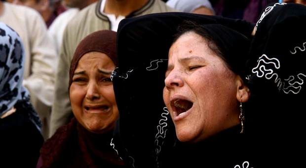 Egyptian women weep after a judge sentenced to death more than 680 people in the latest mass trial in the southern city of Minya, Egypt, Monday, April 28, 2014. (AP Photo/Ahmed Gomaa)