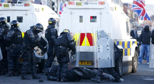Police chiefs were wrong to allow illegal and violent protest marches, the High Court ruled