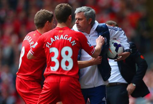 LIVERPOOL, ENGLAND - APRIL 27: Steven Gerrard and Jon Flanagan of Liverpool have words with Jose Mourinho manager of Chelsea during the Barclays Premier League match between Liverpool and Chelsea at Anfield on April 27, 2014 in Liverpool, England. (Photo by Clive Brunskill/Getty Images)
