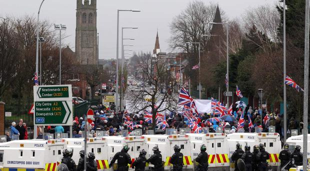 Police lines herd marchers along the Lower Newtownards Road after they passed the Short Strand in January 2013
