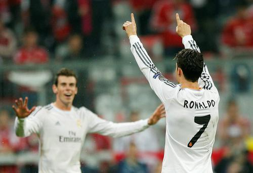 Real's Cristiano Ronaldo celebrates scoring his side's 4th goal during the Champions League semifinal second leg soccer match between Bayern Munich and Real Madrid at the Allianz Arena in Munich, southern Germany, Tuesday, April 29, 2014. (AP Photo/Matthias Schrader)