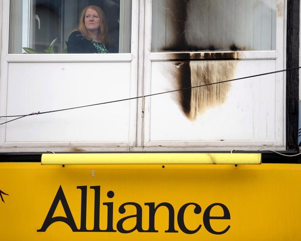 Naomi Long MP inspects the damage at the Alliance office on the Newtownards Road. Colm Lenaghan/Pacemaker