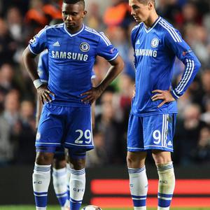 LONDON, ENGLAND - APRIL 30: Samuel Eto'o and Fernando Torres of Chelsea look dejected after the goal by Diego Costa of Club Atletico de Madrid during the UEFA Champions League semi-final second leg match between Chelsea and Club Atletico de Madrid at Stamford Bridge on April 30, 2014 in London, England. (Photo by Jamie McDonald/Getty Images)
