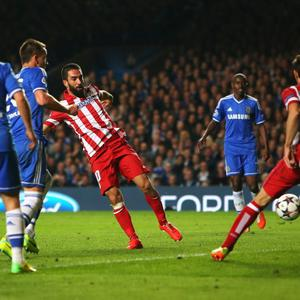 LONDON, ENGLAND - APRIL 30: Arda Turan of Club Atletico de Madrid scores his team's third goal during the UEFA Champions League semi-final second leg match between Chelsea and Club Atletico de Madrid at Stamford Bridge on April 30, 2014 in London, England. (Photo by Clive Rose/Getty Images)