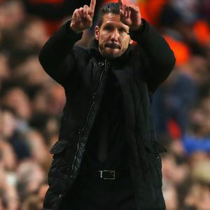 LONDON, ENGLAND - APRIL 30: Diego Simeone, coach of Club Atletico de Madrid acknowledges the fans during the UEFA Champions League semi-final second leg match between Chelsea and Club Atletico de Madrid at Stamford Bridge on April 30, 2014 in London, England. (Photo by Clive Rose/Getty Images)