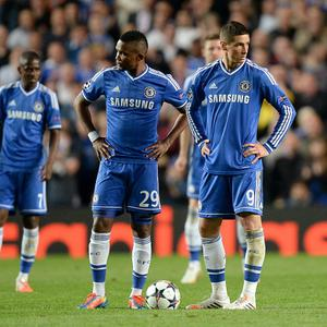 Chelsea's Fernando Torres (right) and Samuel Eto'o stand dejected after conceding a second goal during the UEFA Champions League match at Stamford Bridge, London. PRESS ASSOCIATION Photo. Picture date: Wednesday April 30, 2014. See PA story SOCCER Chelsea. Photo credit should read: Andrew Matthews/PA Wire