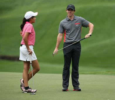 CHARLOTTE, NC - APRIL 30: Alejandra Ayala a 14yr old amateur who won the Wells Fargo Succeding Together contest to play with a player of her choice, talks with Rory McIlroy of Northern Ireland during the pro-am for the Wells Fargo Championship at the Quail Hollow Golf Club on April 30, 2014 in Charlotte, North Carolina. (Photo by Richard Heathcote/Getty Images)
