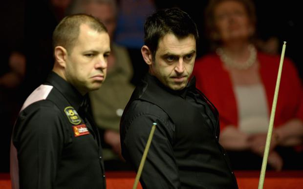 SHEFFIELD, ENGLAND - MAY 02: Ronnie O'Sullivan and Barry Hawkins during their semi final in The Dafabet World Snooker Championship at Crucible Theatre on May 2, 2014 in Sheffield, England. (Photo by Gareth Copley/Getty Images)