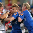 Ulster's Chris Henry is tackled by Leinster's Ian Madigan and Leo Cullen during Friday night's RaboDirect Pro 12 match at Ravenhill