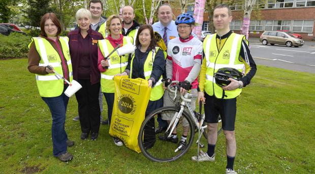 Volunteers help clear litter and rubbish from part of the Giro D 'Italia route at Stranmiullis embankment, Belfast
