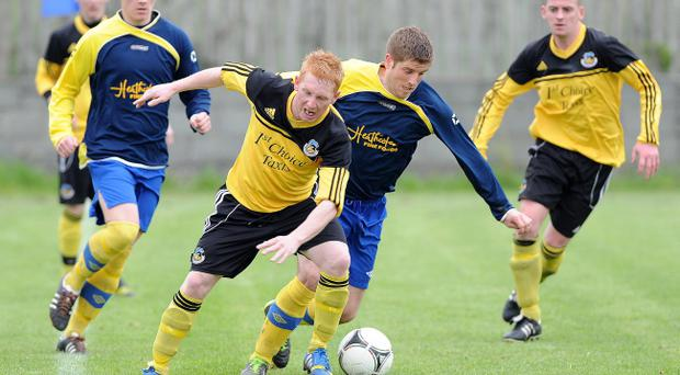 Action from Drumaness Mills v Shankill United, May 3