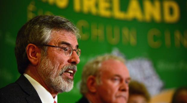 Sinn Fein Leader Gerry Adams speaks during a press conference at Balmoral Hotel after he was released from Antrim PSNI Station