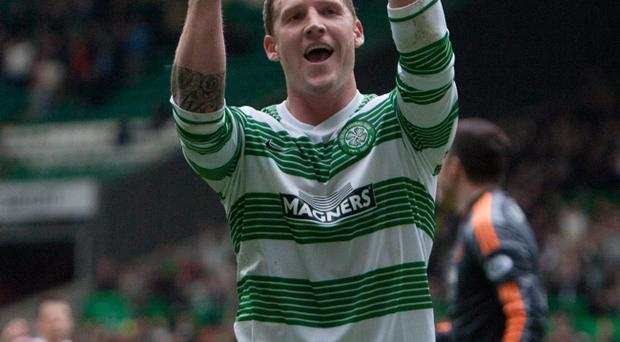 Celtic's Kris Commons gestures to the crowd after his second goal against Aberdeen's during the Scottish Premiership match at Celtic Park, Glasgow
