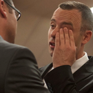 Oscar Pistorius right, is comforted by his brother, Carl Pistorius, inside court in Pretoria, South Africa, Monday May 5, 2014 (AP Photo/Ihsaan Haffejee, Pool)
