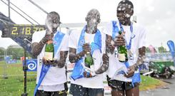 Winner of the 2014 Marathon Freddie Sittuk pictured with Joel Kipsang and Hilary Kipsang