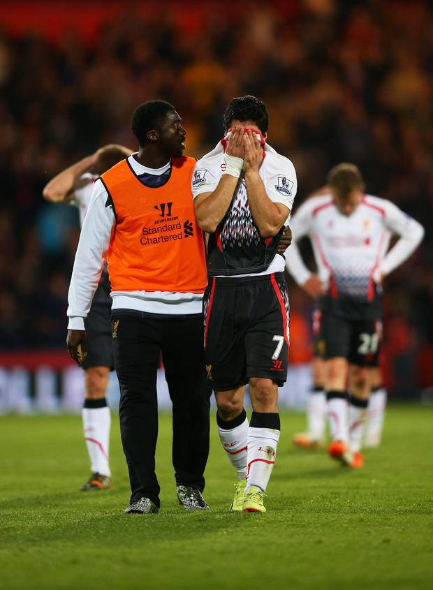Kolo Toure of Liverpool consoles the dejected Luis Suarez of Liverpool following their team's 3-3 draw during the Barclays Premier League match between Crystal Palace and Liverpool at Selhurst Park on May 5, 2014 in London, England. (Photo by Clive Rose/Getty Images)