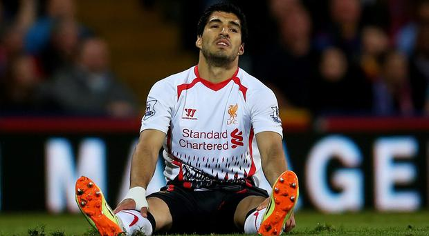 A dejected Luis Suarez of Liverpool reacts during the Barclays Premier League match between Crystal Palace and Liverpool at Selhurst Park on May 5, 2014 in London, England. (Photo by Clive Rose/Getty Images)