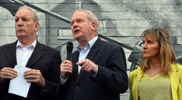 Bobby Storey (left) with Martin McGuinness and Martina Anderson at the Falls Road rally on Saturday