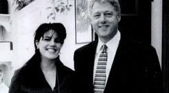 Former White House intern Monica Lewinsky meeting President Bill Clinton at a White House function submitted as evidence in documents by the Starr investigation and released by the House Judiciary committee September 21, 1998.