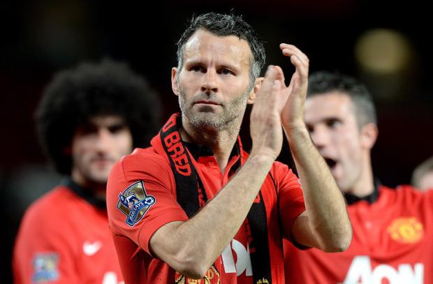 A final goodbye? Ryan Giggs acknowledges the United fans on what could well be his last appearance at Old Trafford as a player