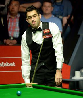 Ronnie O'Sullivan looks dejected after a missed shot against Mark Selby during the final of the Dafabet World Snooker Championships at The Crucible, Sheffield