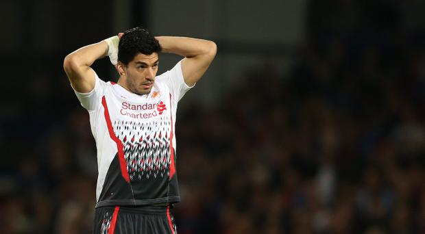 Liverpool's Luis Suarez reacts, after missing a chance on goal in the last few minutes of the English Premier League soccer match between Crystal Palace and Liverpool at Selhurst Park stadium in London, Monday, May 5, 2014. The match ended in a 3-3 draw. (AP Photo/Alastair Grant)